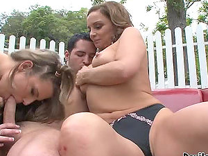 Maxi Booty and Rebecca Bardoux deepthroat a penis outdoors