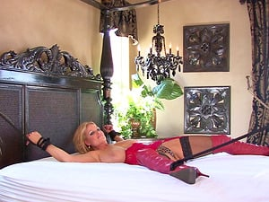 Kelly Madison is a tied up babe ravished by a handsome lover