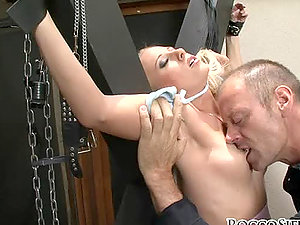 Two tied whores get tormented by the inexhaustible stud Rocco Siffredi