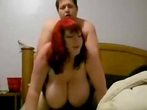 A red haired chubby woman with enormous boobies gets pounded from behind by her lover