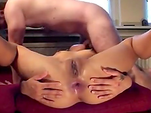 This is a webcam recording of a chick getting her brown pussy and asshole drilled by her man