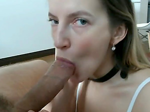 Slutty woman sucks a cock and balls