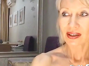 Gorgeous blonde milf plays and cums on web cam
