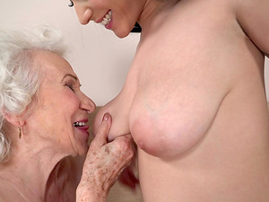 Granny Norma having her pussy sucked by attractive brunette Aysha