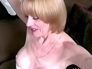 Naughty blonde mature with fake tits and a hot body sucking cock