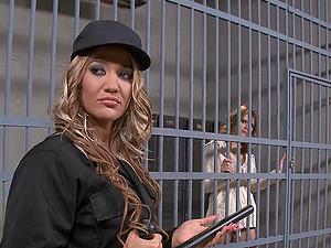 Two hot lesbian girls having fun in prison