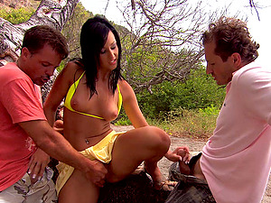 Mandy Saxo likes to fuck with two guys at once on the beach