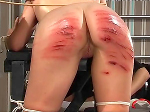 Horny maid gets to punish a naughty girl by hitting her with a stick