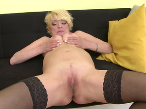 Alisah squeezes her firm boobs while she masturbates with a toy