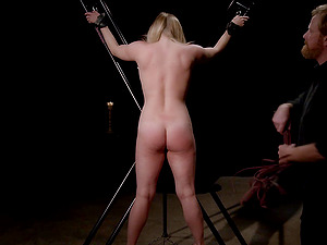 Tied up hottie has to moan while he rubs her cunt with a vibrator