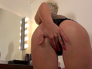 Mature short haired blonde Mandy Mystery strips and masturbates