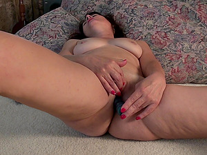 Mature amateur skinny brunette MILF Carrie M. strips and fingers her pussy