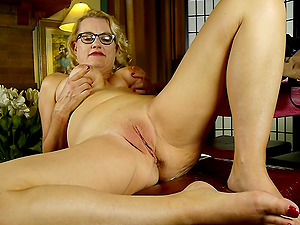 Mature amateur blonde MILF Dalbin strips at her office