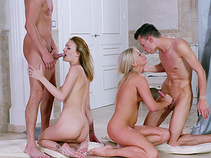 Cayla Lyons and another girl fuck with two guys on the floor