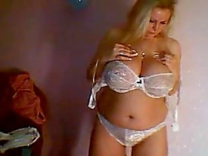 Russian milf with enormous juggs teases and masturbates on livecam