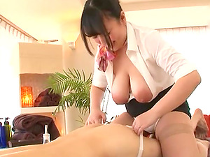 Busty chubby Asian Mochida Yukari massages a cock with her huge tits