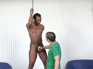 Well hung black gay dude gets his cock stroked by a short Latino gay