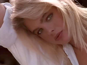 Antique blonde Peggy McIntaggart poses for the webcam in a bedsheet