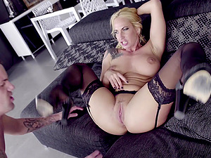 Blonde in silky stockings Sophie Evans rides cock like a nympho