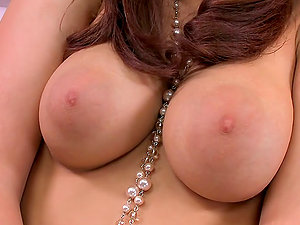 Big-chested cutie Lesperansa shows her terrific assets and thumbs her cunt