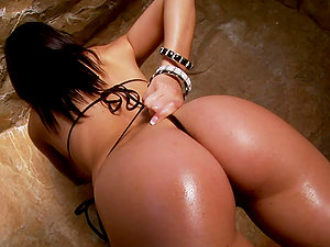 Ann Marie Rios the sexy brown-haired shows her hooters and arse