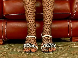 Bambi pulls her fishnet stockings down and boasts of her adorable feet