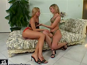 Horny lesbos Judy Wolf and Mia Stone are having joy with a strapon