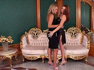 Gorgeous women in black dresses having hot girl-on-girl lovemaking