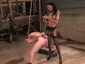 Skinny dark-hued shemale Mistress Soleli fucks kinky dude Zoey in a cellar