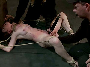 Tied up chick gets whipped and then gives a blow-job