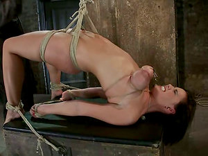 Dark-haired Brooke Lee Adams gets tied up with ropes