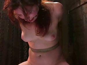 Kimberlee Cline gets her vag toyed while dangling in a basement