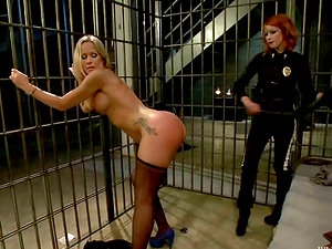 Red-haired Cop Elle Alexandra Fucks and Predominates Blonde Inmate Simone Sonay