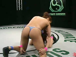 Isis Love and Tory Lane fight and have fun with a strapon on tatami