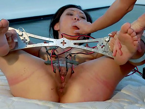 Two Imperious Gals Knuckle Fuck Tia Ling in Restrain bondage Flick
