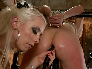 Roxanne Hall gets her snatch fisted and toyed by Lorelei in Bondage & discipline scene