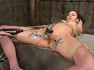 Black-haired bombshell luvs being tormented in a basement