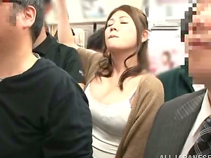 Hot Japanese woman gets finger-tickled in a crowded train