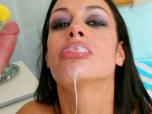 Smoking hot dark haired stunner gets a geyser of jizz in her mouth