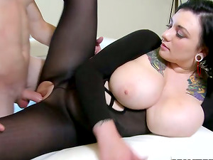 Tattooed black-haired with thick breasts gets fucked hard