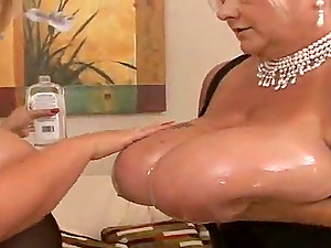 Blonde granny Linda plays lesbo games with a big-boobed chick