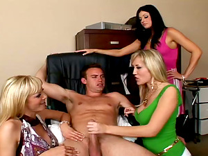 Three clothed females love playing with some sexy stud's man rod