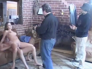 A backstage scene of pretty black-haired getting fucked indoors
