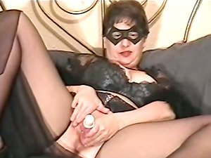 Mature lady in mask is kittling her twat