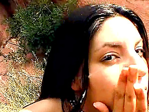 Lustful fledgling chick gives a handjob in the mountains