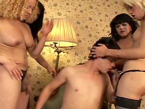 Black-haired twunk does everything he can to please three horny shemales