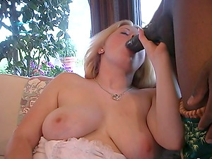 Huge-titted blonde Noel gargles a black boner while leaping on another one