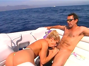 Curly blonde in sunglasses gives hot suck off on a yacht