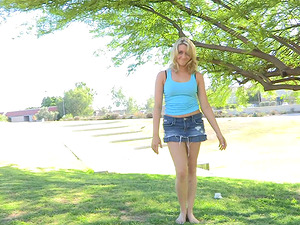 A supple blonde chick shows her snatch in a park