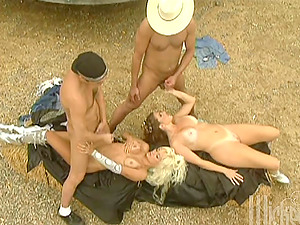 Two elf chicks have a wild four way bang-out outdoors